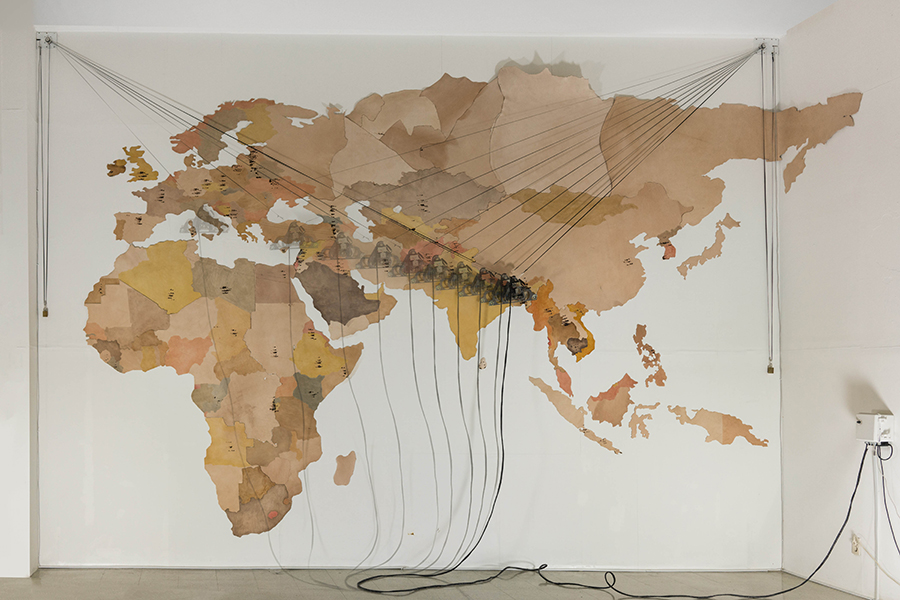 1_Minha LEE_The Scorched World_installation_cow leather, branding iron, vertical plotter, processing_2018_1