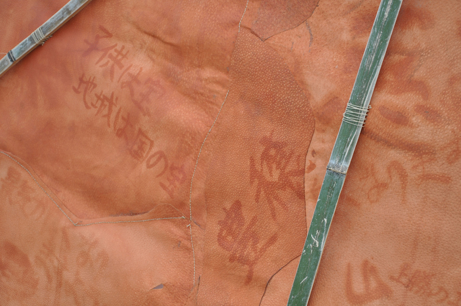 4_Minha LEE_Sanctum Sanctorum_detail view (outside)_pig leather, bamboo, postcards from villagers_(w)1.3x(d)2.5x(h)1.5m_2010