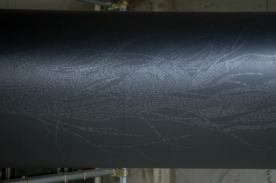 6_Minha LEE_The Monument_detail view (tail)_pencil on black paper tube_7 holy scripts and 15 languages_Ø50x400cm_2008