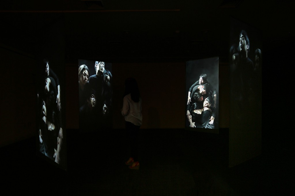 2_Minha LEE_trapped people1_Videon Installation View_Acrylic panel with rear screen projection_7.5x7.5x(h)2.7m_2014